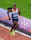 Great Briain runner, Mo Farah, wins the 10,000 meter gold medal in the London Olympics. Galen Rupp, from the USA won the Silver Medal.(AP Photo/Dick Druckman)