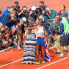 Great Britain 10,000 meter gold medal champion,Mo Farah, gets a kiss from his wife after winning the gold medal, which is caught by the press cameras.