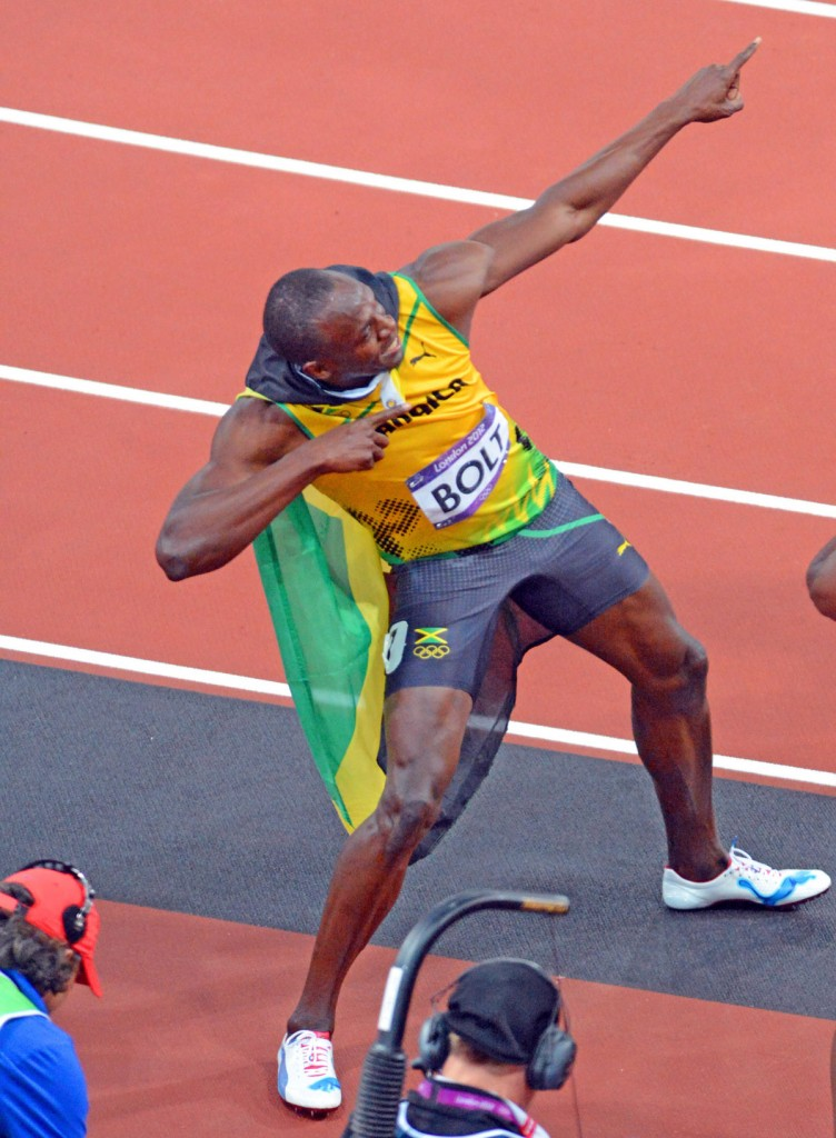 Jamaica running legend, Usain Bolt, flashes his signiture pose-- a lightening bolt after winning the Gold Medal in the men's 100meter event at the London Olympics. Usain set and olympic record of 9.63 seconds.(AP Photo/Dick Druckman)