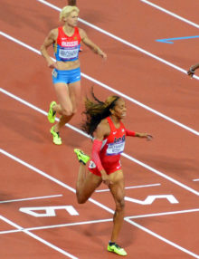 USA runner, Sanya Richards-Ross ,wins the women's 400Meter event. while her partner Trotter earns a bronze medal.