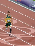 0SCAR PISTORIUS fROM THE REPUBLIC OF SOUTH AFRICA COMPETES IN THE MEN'S 400METER SEMIFINAL. OSCAR COMPETES WITH TWO ARTIFICAL LEGS.