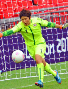 With only minutes remaining in the game, Japan goalie Miho Fukumoto makes critical save against France in the semi-final game at Wembley Stadium. Japan went on to win 2-1 and now faces the US team for the gold medal.(AP Photo/Dick Druckman)