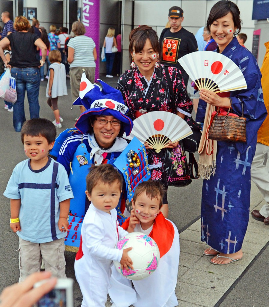 A Japanese family cheer on their team at Wembley Stadium in the Semi-final match against France. Japan won 2-1 and now face the United States team for the gold medal.(AP Photo/Dick Druckman)