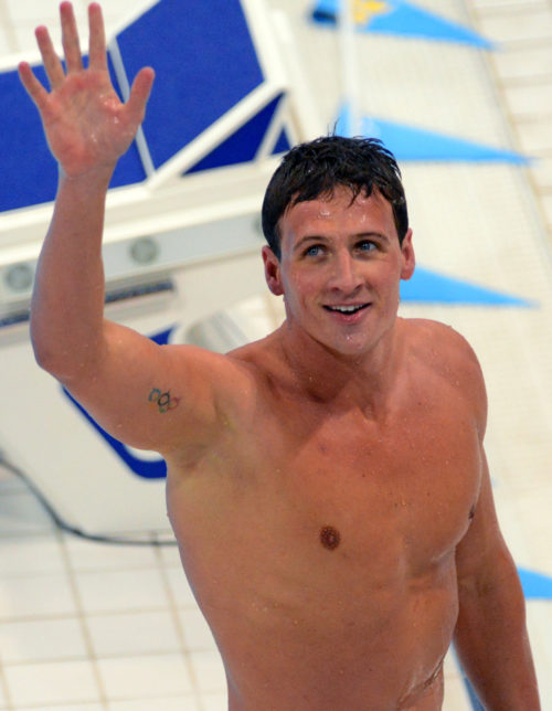 USA swimmer, Ryan Lochte, waves to the crowd after winning the Gold Medal in the Men's Individual Medley Final in the London Olympics. Ryan easily defeated Michael Phelps who earned a fourth place in the event.(AP Photo/Dick Druckman)