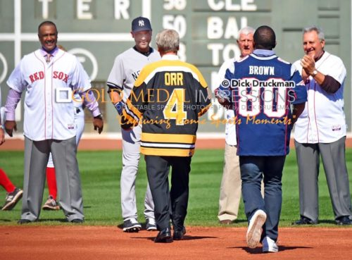 Boston Bruins legend Bobby Orr shakes hands with Derek Jeter as part of the farewell ceremony honoring Derek Jeter's final game of his career at Fenway Park. Derek ended his career going 1 for 2 getting his 3,465th hit and driving in a run as the Yankees defeated the Red Sox 9-5.