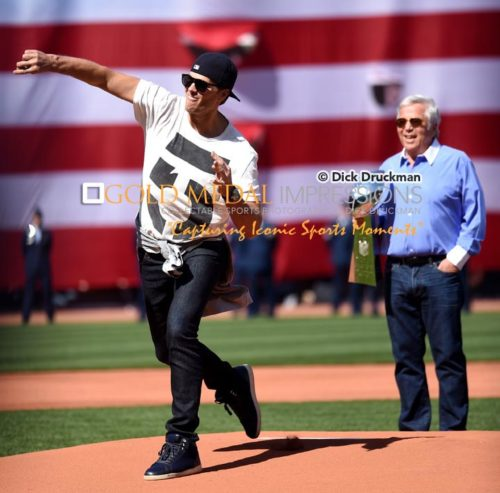 New England Patriots Super Bowl MVP quarterback, TOM BRADY, throws out the first pitch of the Boston Red Sox home opener as Patriots owner ROBERT KRAFT, looks on. The Red Sox went on to defeat the Washington Nationals 9-4.(AP Photo/Dick Druckman)