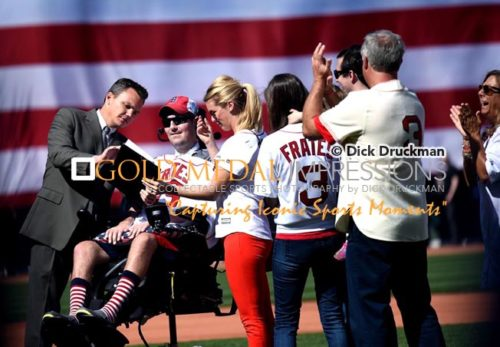 In an emotional segment of the Boston Red Sox home opening ceremonies, ALS spokesperson, PETE FRATES, signs a permanent contract with the Boston Red Sox as his family celebrates the occasion. The Red Sox went on to win 9-4.(AP Photo/Dick Druckman)