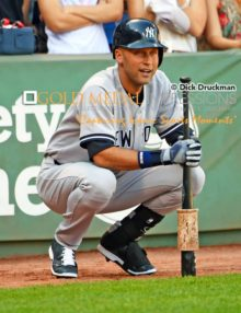 New York Yankeees captain, Derek Jeter, waits patiently in the on deck circle during the last game of his career at Fenway Park in Boston MA. Jeter ended his career going 1 for 2 getting his 3, 465th hit, driving in a run and leading the Yankees to a 9-5 victory over the Boston Red Sox.