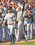 In an historic moment, New York Yankees captain, Derek Jeter, waves goodby to the Boston Red Sox crowd after hitting a single and driving in a run for his 3, 465th hit and the final time at bat of his career.