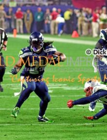 Seattle Seahawks running back, MARSHAWN LYNCH, runs for a first down against the New England Patriots in the third quarter of Super Bowl XLIX. The Patriots rallied to win 28-14.