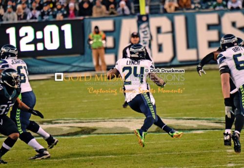 Seattle Seahawks running back, MARSHAWN LYNCH, runs through a gapping hole against the Philadelphia Eagles in the first quarter at Lincoln Financial Field. LYNCH ran for 86 yards leading the Seahawks to a 24-14 victory.