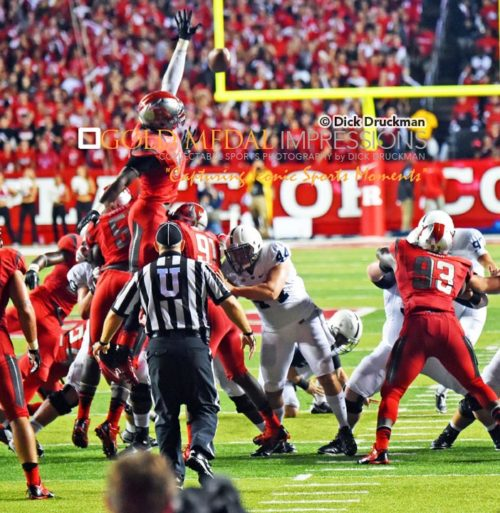 Rutgers University sophomore defensive end, Kemoko Turay, blocks a 34 yard field goal attempt by Penn State kicker, Sam Fliken, in the first half at High Point Solutions Stadium. Penn State went on to win 13-10 to spoil Rutgers Big Ten Conference debut.(AP Photo/Dick Druckman)