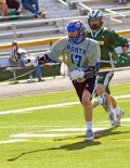 WWP NORTH MIKE BUSH TAKES THE BALL DOWNFIELD. The North South boys game was a thriller with the North winning 13-11. NorthÕs Danny Bellerra led his team with four scores and Mike Domino led South with three goals.
