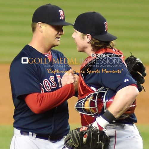 Boston Red Sox relief pitcher, STEVEN WRIGHT, is congratulated by his catcher, RYAN HANIGAN, after defeating the New York Yankees in the 19th inning 6-5. WRIGHT, who was originally slated to be the starting pitcher on Saturday, was called to relieve when the Red Sox ran out of relievers. WRIGHT pitched 5 innings, alloiwing 6 hits 2 runs with 1 strike out but getting the win and the save.(AP Photo/Dick Druckman)