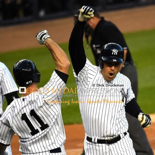 New York Yankees first baseman, MARK TEIXEIRA, celebrates with BRETT GARDNER after hitting a two run home run in the first inning against the New York Mets in the first game of the Subway Series. TEIXEIRA went on to hit a second two run home run in the third inning, leading the Yankees to a 6-1 victory.(AP Photo/Dick Druckman)