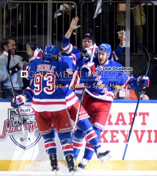 New York Rangers rookie, KEVIN HAYES, celebrates with his teammates after scoring a goal in the second period against the Washington Capitals. The Rangers went on to win 2-1 and now move on to face the Tampa Bay Lightening.(AP Photo/Dick Druckman)