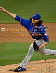 New York Mets starting pitcher, and Rookie of the Year in 2014, JACOB deGROM throws a strike in the first inning of the Subway Series against the New York Yankees. In one of his poorest performances of his career, de Grom gave up eight hits and a career high-tying 6 runs in 5 innings, losing to the New York Yankees 6-1. (AP Photo/Dick Druckman)