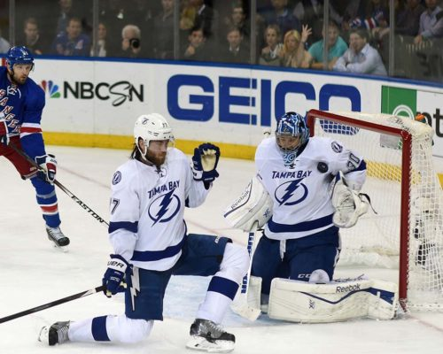 Tampa Bay Lightning goalie, BEN BISHOP, blocks shot in the second period as defensman, VICTOR HEDMAN, watches the play develop. BISHOP had 22 saves, leading the Lightning to a 2-0 victory and a trip to the Stanley Cup Finals.(AP PHOTO/Dick Druckman)
