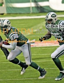 New York Jets quarterback, MICHAEL VICK, runs for an 18 yard first down against the Pittsburgh Steelers in the first quarter at MetLife Stadium. VICK had 8 carries for 39 yards and completed 10 of 18 passes for 132 yards leading the Jets to a 20-13 victory.