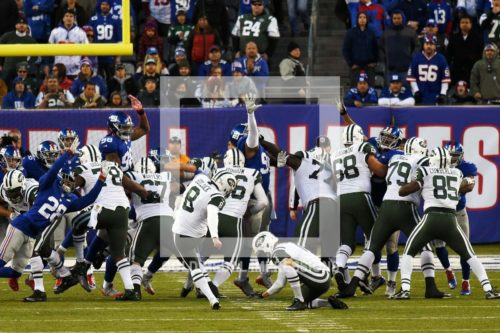 New York Jets kicker RANDY BULLOCK kicks a 31 yard field goal in overtime to defeat the New York Giants 23-20. New York Giants kicker Josh Brown missed a 48 yard field goal with 6:33 left in the extra session giving the Jets a victory.