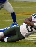 New York Jets wide receiver BRANDON MARSHALL receives a pass from quarterback Ryan Fitzpatrick for a first down in the fourth quarter against the New York Giants. MARSHALL caught 12 passes for 131 yards scoring one touchdown to lead the Jets to a 23-20 victory over the Giants.
