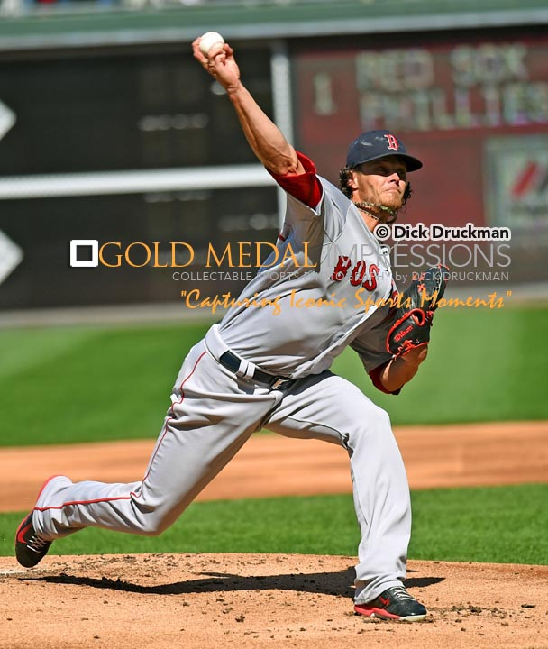 Boston Red Sox starter, CLAY BUCHHOLZ, pitches a 7 inning shutout against the Philadelphia Phillies, at Citizens Bank Park, allowing only three hits, one walk, and striking out 8 batters. The Red Sox went on to win 8-0, with five home runs.(AP Photo/Dick Druckman)