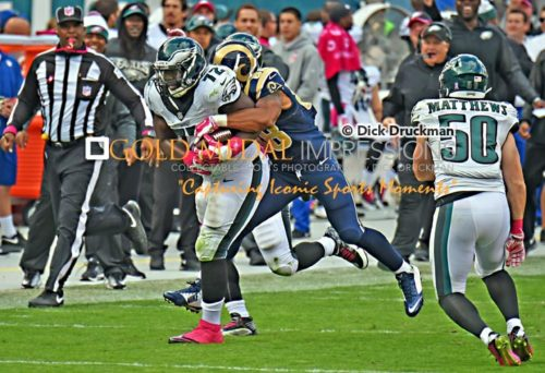 Late in the third quarter, Philadelphia Eagles defensive end Cedric Thornton picks up his second fumble this time by St. Louis Rams running back Zac Stacy and returns it 40 yards to set up a Nick Foles touchdown pass to Jeremy Macliln. The Eagles went on to win 34-28, going 4-1 to start their season.(GOLD MEDAL IMPRESSIONS/Dick Druckman)
