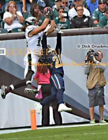 With 30 seconds left in the second quarter, Philadelphia Eagles wide receiver Riley Cooper out jumps St. Louis Rams cornerback Janoris Jenkins for a 9 yard touchdown giving the Eagles a 20-7 lead to end the first half. The Eagles with a strong effort by their defense and special teams defeated the Rams 34-28.