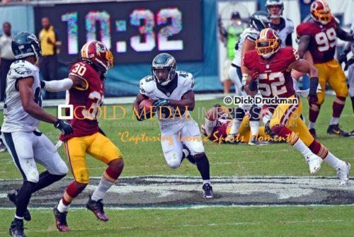 Philadelphia Eagles running back Darren Sproles runs for a 22yard first down in the third quarter against the Washington Redskins. The Eagles went on to win 37-34.(AP Photo/Dick Druckman)