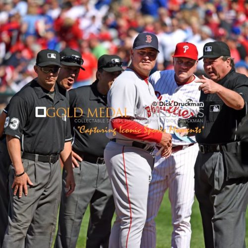 Philadelphia Phillies Manager, RYNE SANDBERG, and Boston Red Sox Manager, JOHN FARRELL, get briefed by the grounds crew prior to the Phillies Home Opener at Citizens Bank Park. The Red Sox went on to defeat the Phillies 8-0.(AP PHOTO/Dick Druckman)