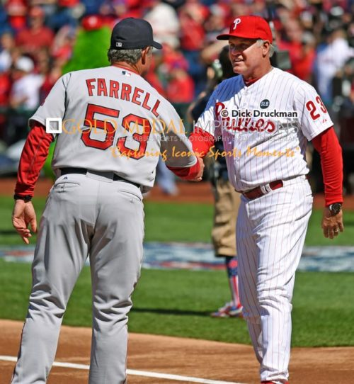 Philadelphia Phillies Manager, RYNE SANDBERG, and Boston Red Sox Manager, JOHN FARRELL, shake hands prior to the Phillies Home Opener at Citizens Bank Park. The Red Sox went on to defeat the Phillies 8-0.(AP Photo/Dick Druckman)