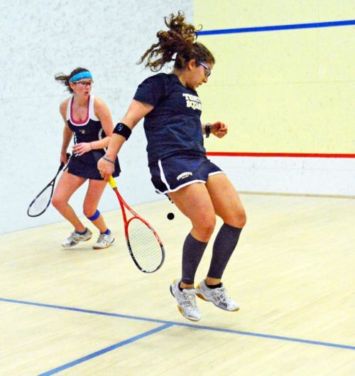 Trinity College Kanzy El Defrawy makes a behind the back shot in the women's squash individual national championships at Drexel Universty. Kanzy lost in the final championship match to Harvard University Amanda Sobyh 3-0.(AP Photo/Dick Druckman)