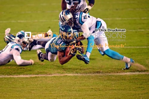 Philadelphia Eagles wide receiver, JORDAN MATTHEWS, scores his second touchdown against the Carolina Panthers in the fourth Quarter as Panthers safety TRE BOSTON attempts to defend. The Eagles went on to win 45-21.