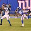 Indianapolis Colts wide receiver, REGGIE WAYNE, catches a 40 yard touchdown pass in the third quarter as New York Giants cornerback, JAYRON HOSLEY is beaten on the play. WAYNE had 4 receptions for 70 yards and one touchdown leading the Colts to a 40-24 victory.