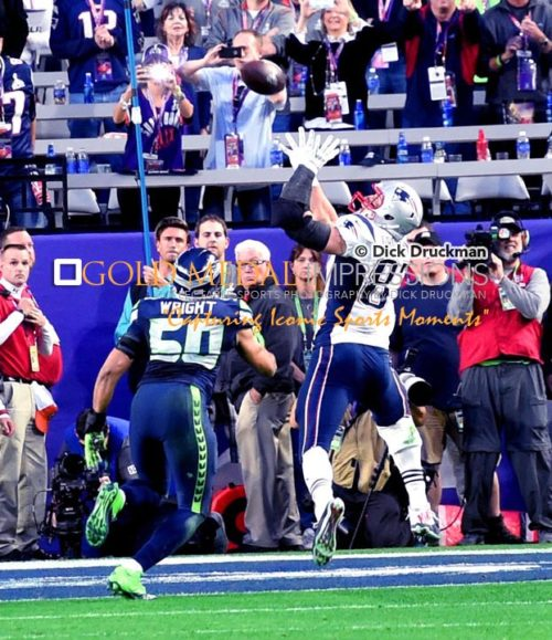 New England Patriots tight end, ROB GRONKOWSKI, catches a touchdown pass behind Seattle Seahawks linebacker KJ WRIGHT in the second quarter of Super Bowl XLIX. The Patriots went on to win 28-24.