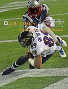 Baltimore Ravens wide receiver, STEVE SMITH SR. catches touchdown pass in the first quarter as New England Patriots cornerback DARRELLE REVIS, attempts to defend giving the Ravens a 14-0 early lead.