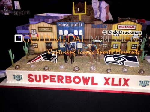 This SUPER BOWL XLIX CAKE was featured at one of the pregame parties-TASTE OF THE NFL . It was prepared by Buddy Valastros(The Cake Boss) --- a family owned business called Carlo's Bakery from Hoboken New Jersey.