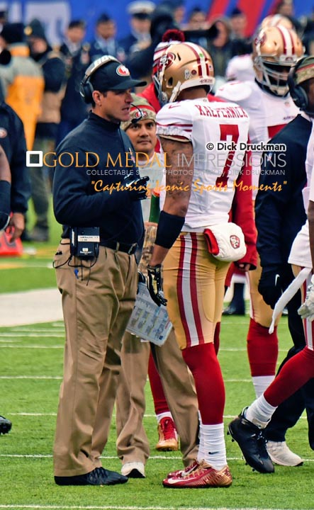 SanFrancisco 49ERS head coach JIM HARBAUGH talks with quarterback COLIN KAEPERNICK on the sidelines in the third quarter against the New York Giants at MetLife Stadium. The 49ERS went on to win 16-10.