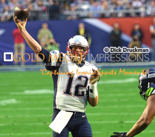 New England Patriots quarterback TOM BRADY completes pass against the Seahawks. Brady who completed 37 of 50 passes for 328 yards surpassing Joe Monta's record for the most touchdown passes in a Super Bowl was selected as Super Bowl XLIX MVP. New England Patriots quarterback TOM BRADY completes pass against the Seahawks.