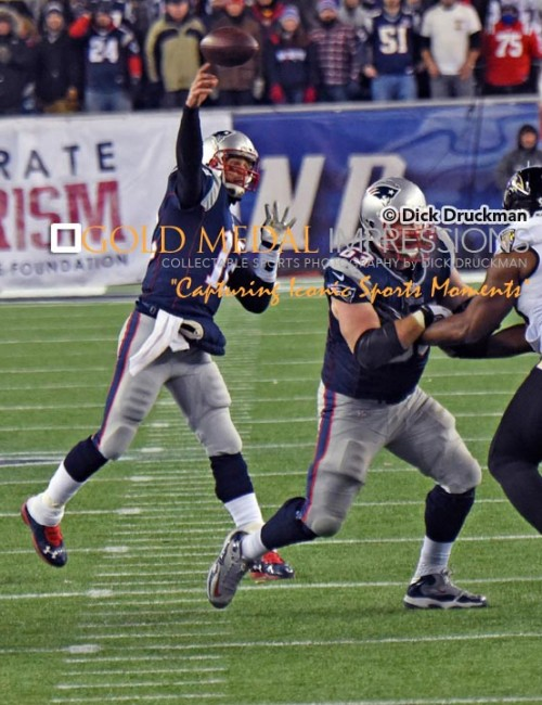New England Patriots quarterback, TOM BRADY, completes pass in the fourth quarter of the NFC divisional playoff game against the Baltimore Ravens. The Patriots went on to win 35-31