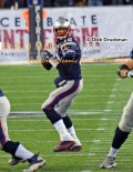 New England Patriots quarterback, TOM BRADY. looks downfield for his receiver in the fourth quarter of the NFC divisional playoffs against the Baltimore Ravens. The Patriots went on to win 35-31.