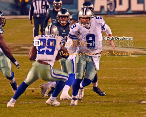 Dallas Cowboys quarterback, TONY ROMO, hands the ball oiff to running back DEMARCO MURRAY in the second quarter against the Philadelphia Eagles at Lincoln Financial Field. Murray ran for 81 yards on 31 carries, scoring 2 touchdowns leading the Cowboys to a 38-27 victory.