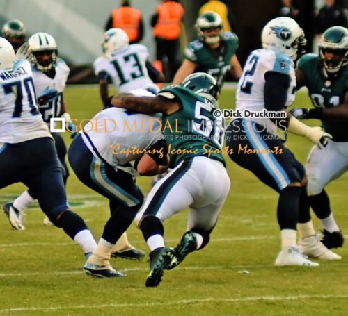 Philadelphia Eagles linebacker, TRENT COLE, sacks Tennessee Titans quarterback, ZACH METTENBERGER, in the third quarter at Lincoln Financial Field. COLE had 2 of the Eagles 5 sacks, leading the Eagles to a 43-24 victory.