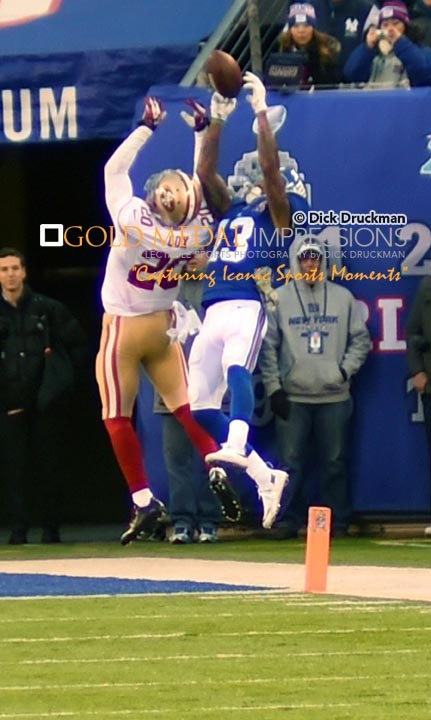 New York Giants rookie wide receiver, ODELL BECKHAM JRL leaps and catches a pass over the outstretched arms of 49ERS cornerback PERRISH COX in the fourth quarter at Met Life Stadiium. The Giants had first down on the 4 yard line and were unable to score and lost 16-10.