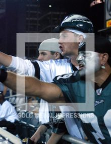 2003 AVID EAGLES FAN SHAUN YOUNG POINTS TO THE ACTION