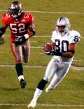 Oakland Raiders wide receiver Jerry Rice scores a touchdown in the fourth quarter against the Tampa Bay Buccaneers while line backer Nate Webster trails Rice into the end zone. Desplte the efforts of Rice, Tampa Bay won 48-21.(AP Photo/Dick Druckman)