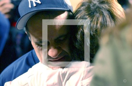 New York Yankees Manager Joe Torre gets a hug from his wife Ali after the Yankees won game 7 of the American League Championship Series against the Boston Red Sox at Yankee Stadium on October 16, 2003. The Yankees won 6-5 in 11 innings and now face the Florida Marlins in the World Series.(AP Photo/Dick Druckman)