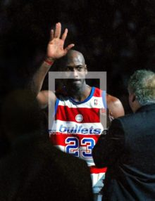 Washinton Wizards Michael Jordan waves goodby to his fans after his final home game against the New York Knicks at the MCI Center. Michael scored twenty-one points in a losing effort 79-93.