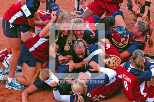 U.S. softball team celebrates a 5-1 victory over Australia in the gold medal game in Athens Greece on August 23, 2004. (AP Photo/Dick Druckman)