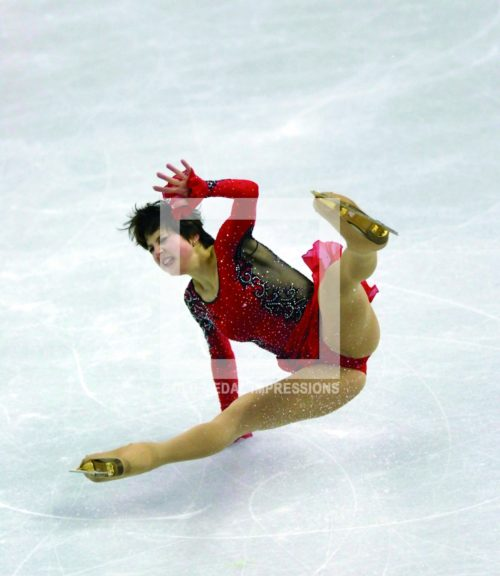 Russia Irina Slutskaya takes a disasterous fall in her attempt to win a gold medal in the women's ice skating final in Torino, Italy on February 23, 2006. Irina won the Bronze Medal.(AP Photo/Dick Druckman)